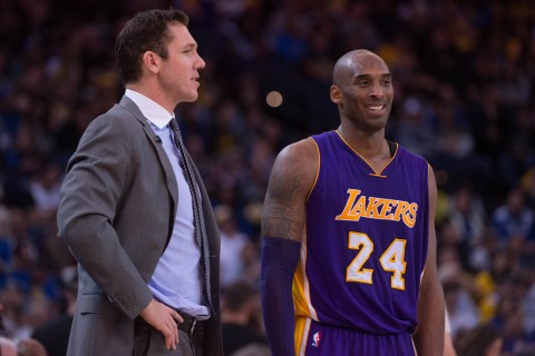 January 14, 2016; Oakland, CA, USA; Golden State Warriors interim head coach Luke Walton (left) talks to Los Angeles Lakers forward Kobe Bryant (24) during the third quarter at Oracle Arena. The Warriors defeated the Lakers 116-98. Mandatory Credit: Kyle Terada-USA TODAY Sports