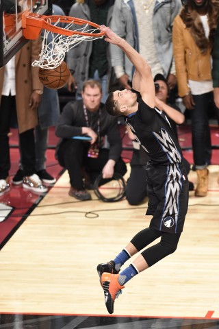 Minnesota Timberwolves Zach LaVine 2016 slam dunk contest champ reverses the rock through the iron Saturday Night at Air Canada Centre. (photo Peter Llewellyn / USA TODAY Sports)