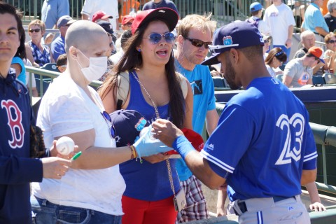 Dalton Pompey signs for the fans. (EDDIE MICHELS PHOTO)