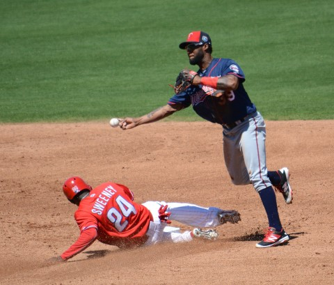 Minnesota Twins shortstop Eduardo Nunez makes the turn at second base Tuesday as Philadelphia's Darnell Sweeney slides into the bag. (photo Buck Davidson)