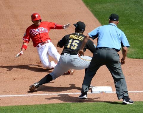 The Philadelphia Phillies Cesar Hernandez slides in with a two-run triple as Pittsburgh Pirates third baseman Jason Rogers awaits the throw. (photo Buck Davidson)