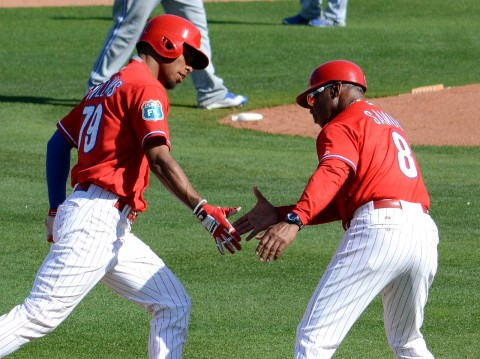 Philadelphia Phillies outfielder Nick Williams is congratulated by third base coach Juan Samuel after Williams' key three-run homer against Toronto on Saturday. (photo Buck Davidson)