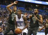 Giannis Antetokounmpo (34) and Greg Monroe (15) watch as Orlando Magic center Dewayne Dedmon (3) drives during the second half.. (phhoto Reinhold Matay / USA TODAY Sports)