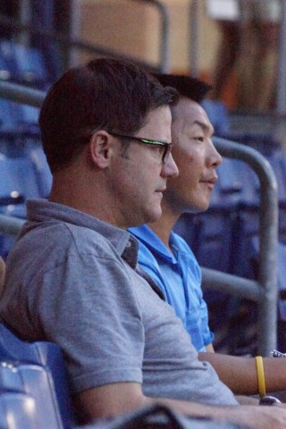 Blue Jays GM Ross Adkins (foreground) and Player Development head Gil Kim take in the Dunedin vs Clearwater Florida State League game on Tuesday May 10th. (EDDIE MICHELS PHOTO)