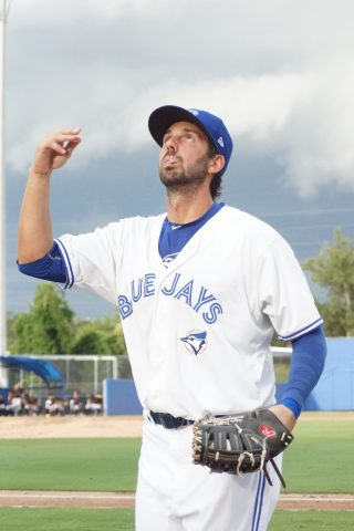 Chris Colabello Tosses a Ball to a Kid in the Stands (EDDIE MICHELS PHOTO)