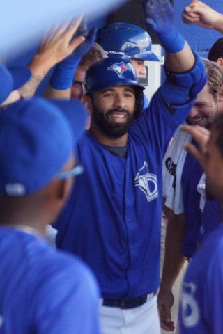 "On the smiles after his first inning home run Bautista said, ""When you do something good you are allowed to enjoy it."" (EDDIE MICHELS PHOTO)"