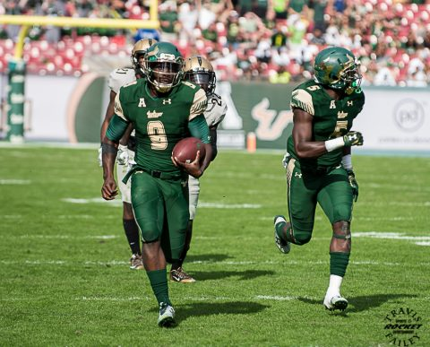 Quarterback Quinton Flowers set the program's new season rushing record with 1,425 yards after producing 152 yards and two scores on the ground. The junior from Miami also completed 17 of 26 passes for 152 yards to set a new USF record with eight 300-yard total offense games this season. (TRAVIS FAILEY PHOTO)